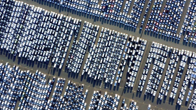 vidéos et rushes de new cars lined up at industrial factory port - stationary
