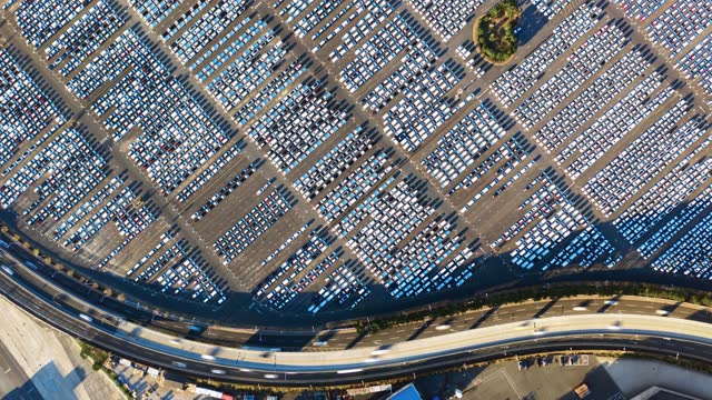 new cars lined up at industrial factory port - automobilindustrie stock-videos und b-roll-filmmaterial