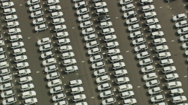 aerial new cars on car plant's parking lot, leipizg, germany - stillstehen stock-videos und b-roll-filmmaterial
