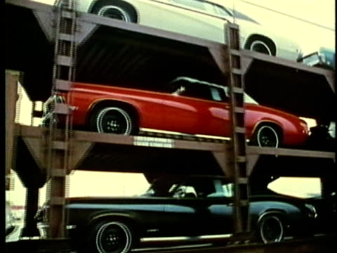 vídeos de stock, filmes e b-roll de montage, new cars shipment, 1960's, detroit, michigan, usa - 1960 1969