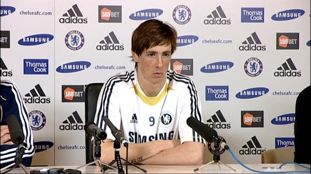new chelsea signing fernando torres photocall and press conference; england: surrey: cobham: int **beware flash photography** fernando torres posing... - fototermin stock-videos und b-roll-filmmaterial