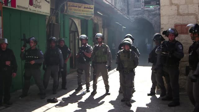 new clashes broke out monday between palestinians and israeli police who stormed jerusalems flashpoint al aqsa mosque compound as an expected... - compounding stock videos and b-roll footage