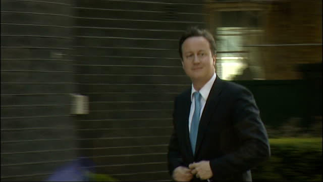 First Cabinet meeting arrivals ENGLAND London Downing Street EXT Two unidentified men arriving / Lord Strathclyde arriving and waving / David Cameron...