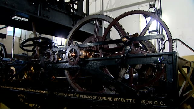 new coin helps big ben strike on time; various shots of sections of mechanism coming into action as clock chimes sot close up new 5 pound coin close... - machine part stock-videos und b-roll-filmmaterial