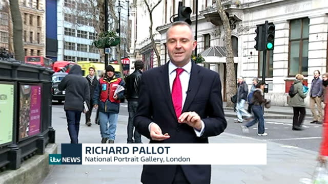 new coin portrait of queen elizabeth ii unveiled ext reporter to camera close shot new two pound coin being held up - richard pallot stock-videos und b-roll-filmmaterial