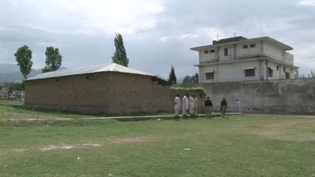new compilation of the exteriof of osama bin laden's compound in abbottabad taken between may 37 abbottabad pakistan - compounding stock videos and b-roll footage