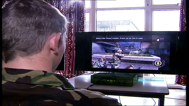 new computer game training for soldiers england london chelsea barracks int soldiers training on new computer game 'full spectrum warrior' to learn... - loss stock videos & royalty-free footage