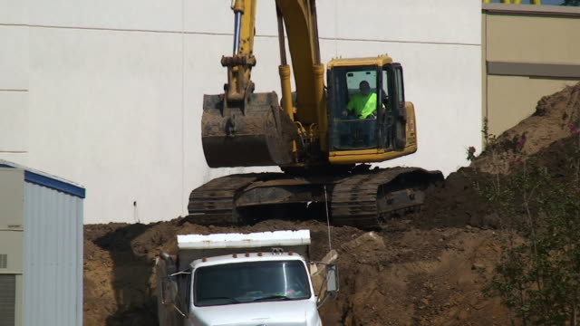 new construction - dump truck stock videos and b-roll footage