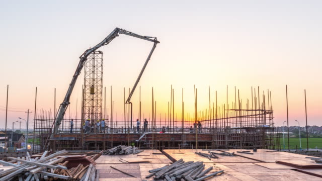 new constructions site in modern city at sunrise.time lapse - rod stock videos and b-roll footage