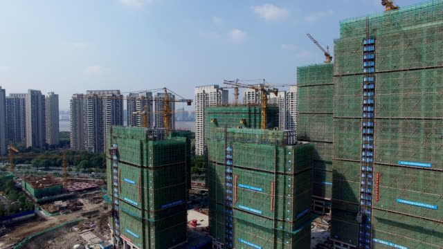new constructions site in modern city. - scaffolding stock videos & royalty-free footage