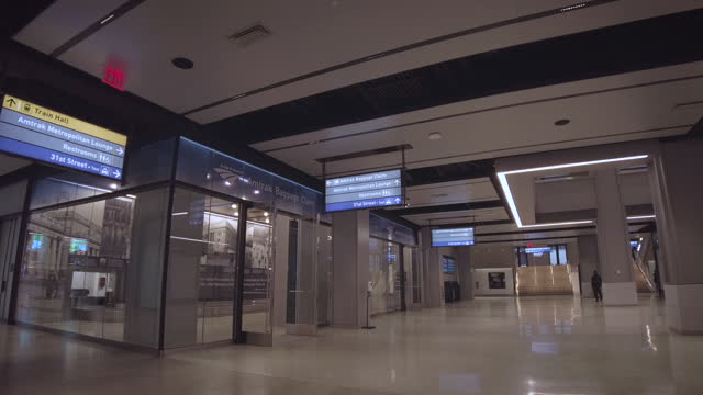 new daniel patrick moynihan train hall pennsylvania station expansion building interior. empty hallway without people. filmed during the coronavirus... - new york city penn station stock videos & royalty-free footage