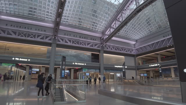 new daniel patrick moynihan train hall pennsylvania station expansion building interior. filmed during the coronavirus pandemic . with people wearing... - new york city penn station stock videos & royalty-free footage