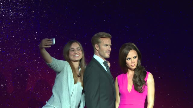 broll new david beckham and victoria beckham figures unveiled at madame tussauds at madame tussauds on june 19 2014 in london england - メリルボーン点の映像素材/bロール