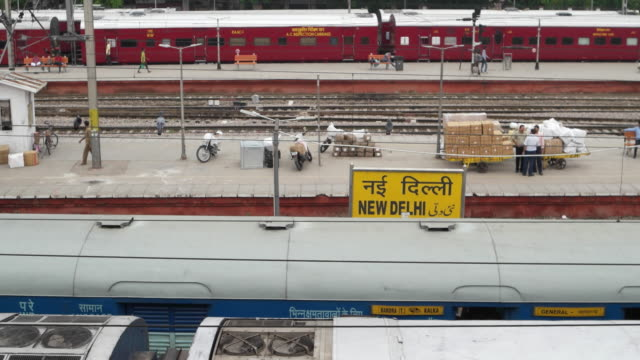 New Delhi Railways Station (Code NDLS) railway station platform with the sign board in English, Hindi and Urdu