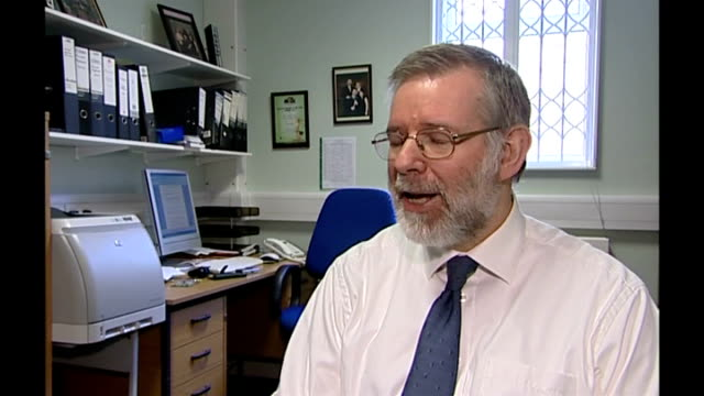 new drug may reduce fractures for osteoporosis sufferers; dr richard eastell interview sot dr richard eastell lifting medical book from shelf and... - osteoporosis stock videos & royalty-free footage