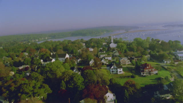 AERIAL New England town + river in Autumn