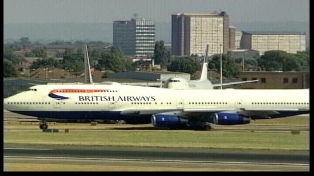 new environmental air tax creates controversy ext british airways jumbo jet with painted tail wing taxiing on runway - tail wing stock videos and b-roll footage