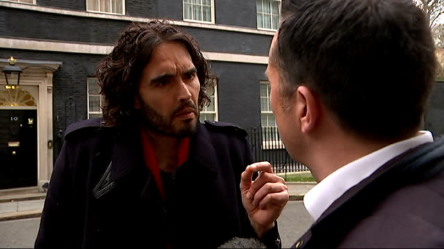 New Era housing estate residents protest at Downing Street Lindsey Garrett interview SOT/ Russell Brand interview SOT I'm not interested in talking...