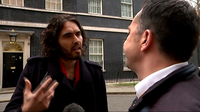 new era housing estate residents protest at downing street / russell brand interview russell brand interview sot - downing street stock-videos und b-roll-filmmaterial