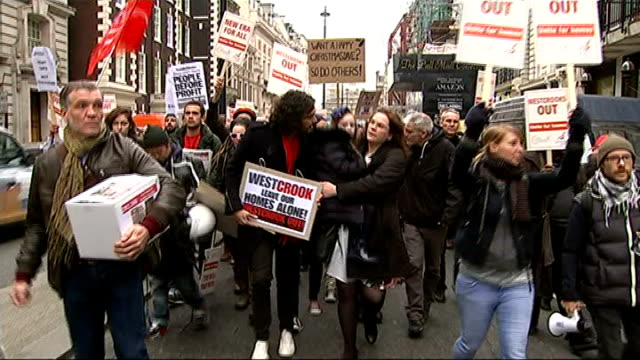 new era housing estate to be sold to affordable housing group: campaigners celebrate; r01121401 / tx 1.12.2014 london: russell brand and protesters... - itv london tonight weekend stock videos & royalty-free footage