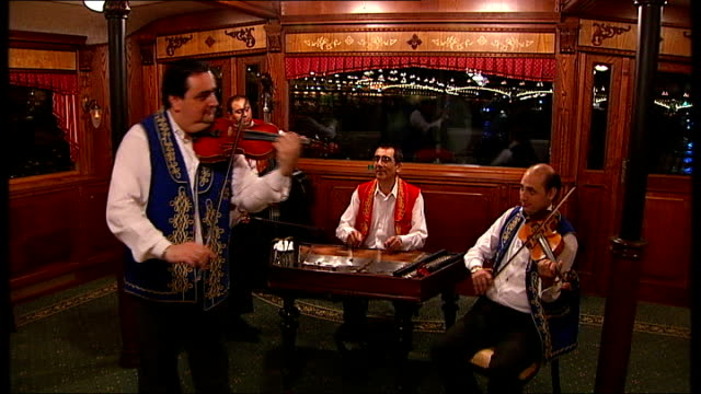 rise of farright party jobbik int musicians playing on boat trip for delegates of world jewish congress sot - channel 4 news stock videos & royalty-free footage