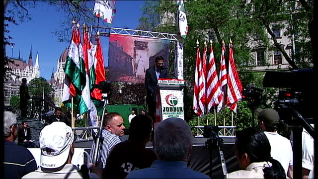 Rise of farright party Jobbik Wide shot Gabor Vona addressing crowd at rally Vona addressing rally Men standing in crowd Marton Gyongyosi at podium...