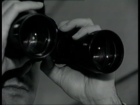 new evidence itn cms person looking through binoculars - canocchiale video stock e b–roll
