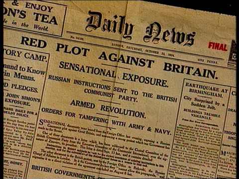 """new evidence; itn england: london: foreign office: ext i/c int tcms copy of the """"daily news"""" newspaper from 1924 with headline """"red plot against... - daily mail stock videos & royalty-free footage"""