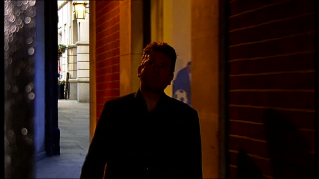new evidence shows possible identity of 'jack the ripper'; london: ec3 ext street lamp on wall set-up shot of richard jones walking along alleyway... - witness stock videos & royalty-free footage