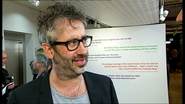 new exhibition at london's jewish museum celebrates jewish stars david baddiel interview sot on why jews good at comedy 'odeon' sign pan reporter to... - odeon cinemas stock videos & royalty-free footage