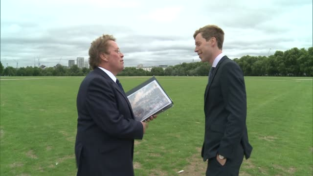 new exhibition tracing history of london's royal parks daniel hearsum interview and showing reporter picture of military review in hyde park sot - durchpausen stock-videos und b-roll-filmmaterial
