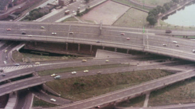 1976 montage new expressways and freeways are a major part of redeveloping the city / united kingdom - major road bildbanksvideor och videomaterial från bakom kulisserna