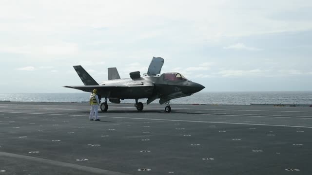 new f-35b lightning fighter jet prepares to take off from the deck of the united kingdom's new aircraft carrier, the hms queen elizabeth in the... - fighter stock videos & royalty-free footage