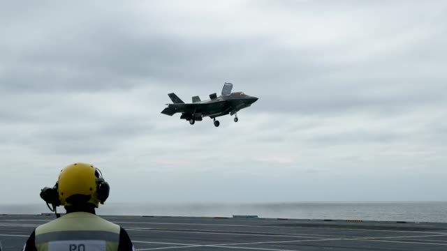 a new f35b lightning fighter jet prepares to take off from the deck of the united kingdom's new aircraft carrier the hms queen elizabeth in the... - b rolle stock-videos und b-roll-filmmaterial
