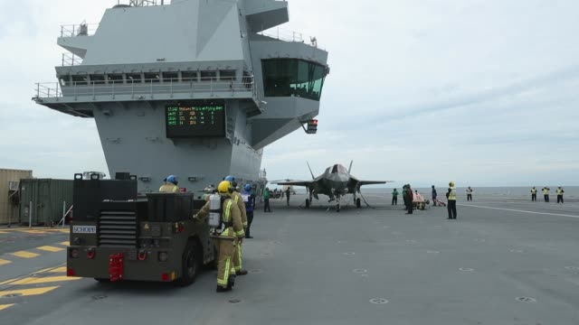 new f-35b lightning fighter jet prepares to take off from the deck of the united kingdom's new aircraft carrier, the hms queen elizabeth in the... - air vehicle stock videos & royalty-free footage