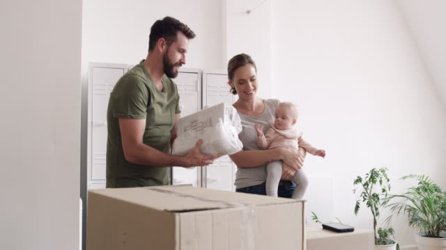 new family making a brand new start - unpacking stock videos & royalty-free footage
