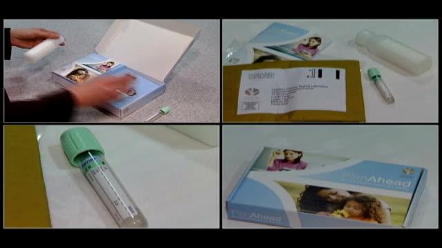 vídeos de stock e filmes b-roll de int ms woman opens 'plan ahead' fertility testing box seq 'plan ahead' fertility testing kit london gir professor bill ledger interview sot the kits... - ovário