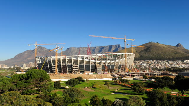t/l new fifa 2010 cape town stadium under construction in greenpoint with table mountain in background, south africa - fifa stock videos & royalty-free footage
