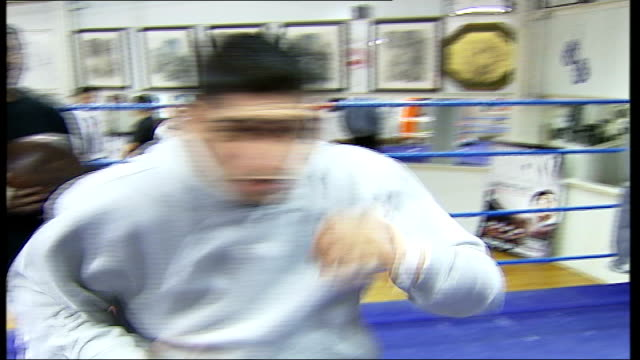 """new film """"rocky balboa"""" / amir khan interview; amir khan interview sot - he can do it / my next fight is on 17 feb over at wembley arena / looking... - wembley arena stock videos & royalty-free footage"""