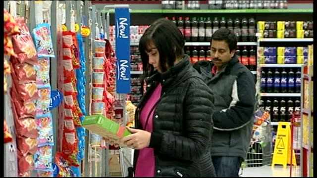 new food labelling system to be introduced to encourage healthy eating scotland glasgow int woman looking at ready meals in the chilled food section... - labelling stock videos & royalty-free footage