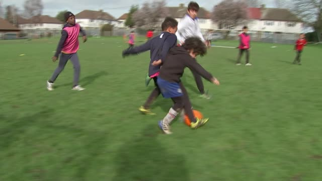 new football association guidelines sat primary schoolchildren should not head footballs in training; england: london: ext various of anton mckenzie... - primary school child stock videos & royalty-free footage