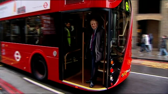 new generation of hop-on, hop-off 'boris buses' on route 24; england: london: ext conductor standing at back of 'hop on / hop off' new bus for london... - new stock videos & royalty-free footage