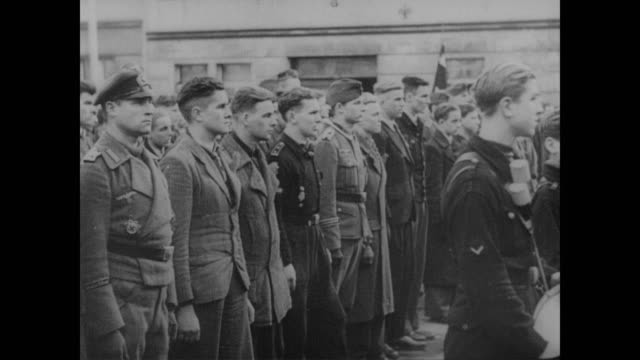 new german army recruits gather in town square in front of officers and crowd - deutsches militär stock-videos und b-roll-filmmaterial