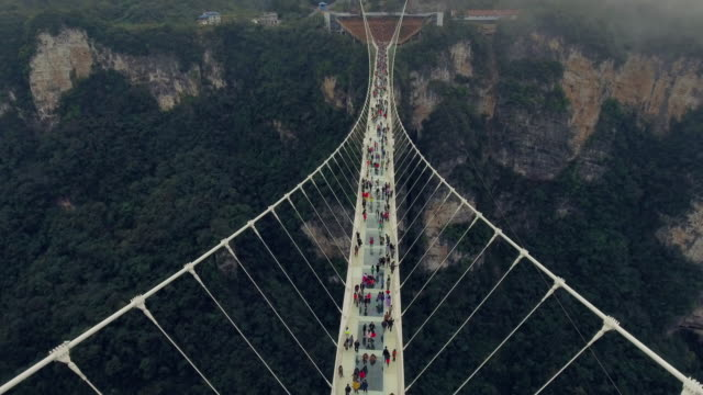 new glass bridge of hunan china - suspension bridge stock videos & royalty-free footage