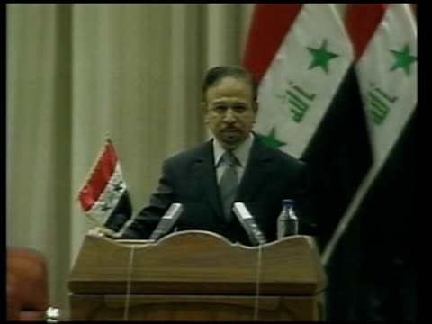baghdad iraqi prime minister ibrahim aljaafari speaking at podium at swearingin ceremony sot this blessed gathering has come to install the first... - iraqi prime minister stock videos & royalty-free footage