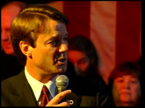 New Hampshire INT Senator John Edwards along onto stage as announced to large cheer PULL OUT SOT CMS Edwards laughing as making rally speech SOT...