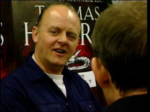 london charing cross road murder one man dressed up as hannibal lecter handing bag and book to customer at launch of sequel hannibal by thomas harris... - charing cross stock videos and b-roll footage