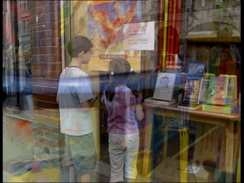new harry potter book on sale tonight; itn england: london: muswell hill: ext gv children's bookshop bookshop sign int books on rack spinning around... - publication stock videos & royalty-free footage