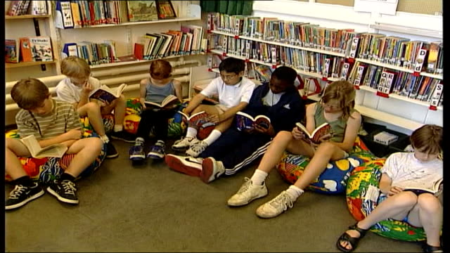 new harry potter film preview lib child buying harry potter book in book shop children sitting in library reading harry potter books - harry potter stock videos & royalty-free footage