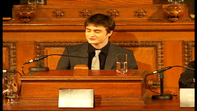 stockvideo's en b-roll-footage met new harry potter film stars of 'harry potter and the order of the phoenix' seated in county hall council chamber including radcliffe rupert grint and... - harry potter naam kunstwerk